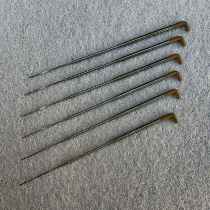A set of six 40 gauge spiral felting needles.